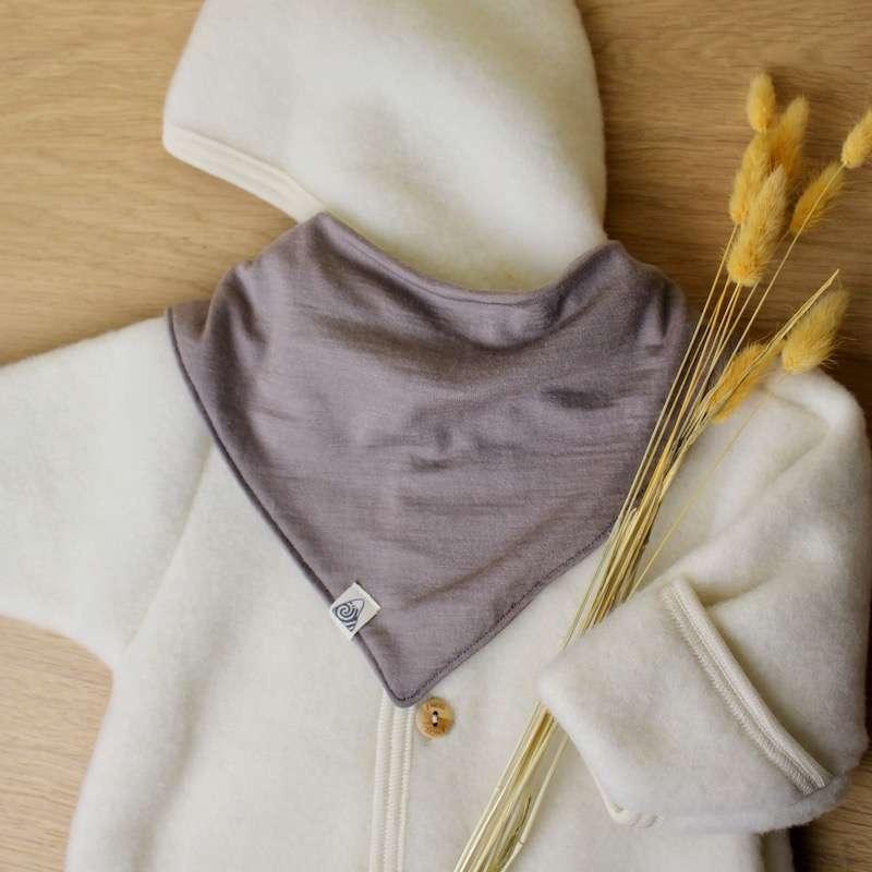 handmade merino baby bib sandy grey and Engel natur jacket